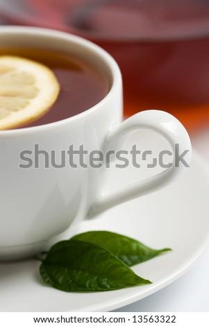 cup of black tea with lemon - stock photo