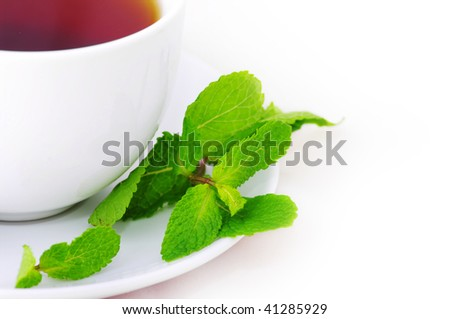 Cup of black tea with mint