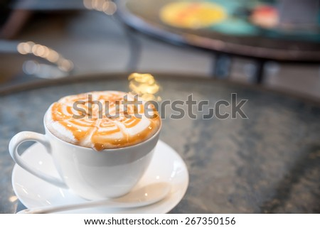 Cup of cappuccino coffee on the table - stock photo