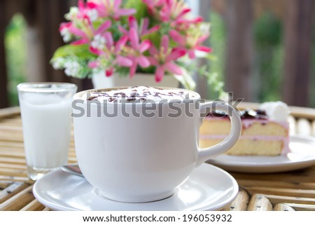 Cup of cappuccino coffee with cake - stock photo