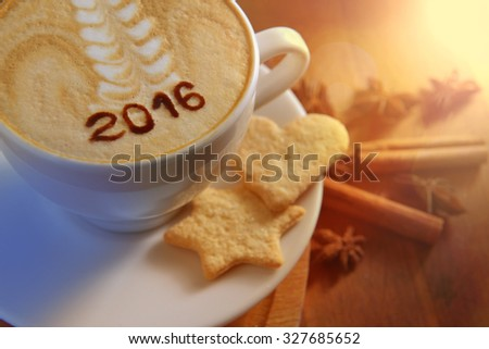 Cup of cappuccino with Christmas symbols - stock photo