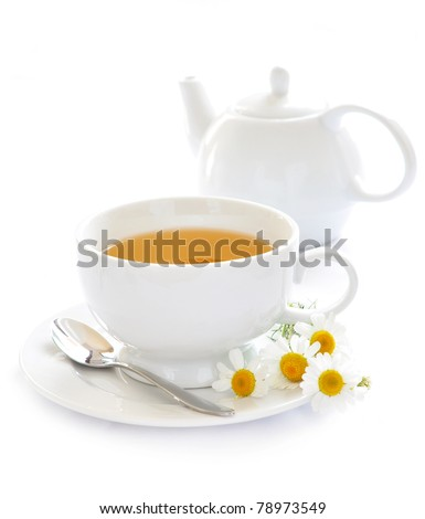 Cup of chamomile tea - stock photo