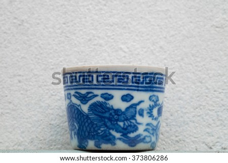 Cup of chinese tea on white background