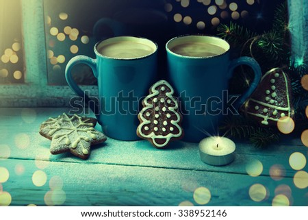 Cup of chocolate and gingerbread cookies. Christmas time. - stock photo