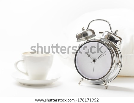 Cup of coffe and alarm clock.  - stock photo