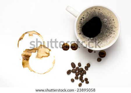 Cup of coffe and coffee stains - stock photo