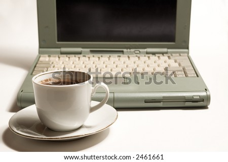 Cup of coffe and laptop on white backgrounds