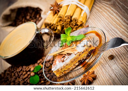Cup of coffee and a cake on wooden background - stock photo