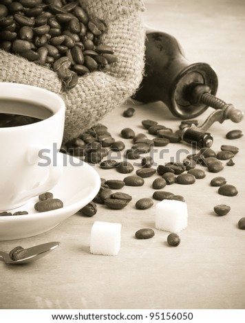 cup of coffee and beans on wood texture