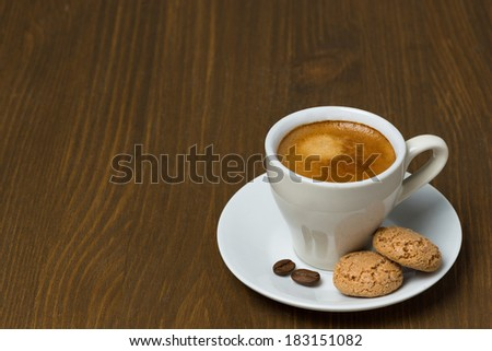 cup of coffee and biscotti on a wooden table and space for text, horizontal - stock photo