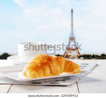 Cup of coffee and croissant in Paris. French cafe. - stock photo