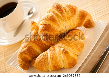 cup of coffee and croissants served for breakfast - stock photo