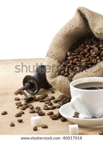 cup of coffee and grinder with roasted beans isolated on white background - stock photo