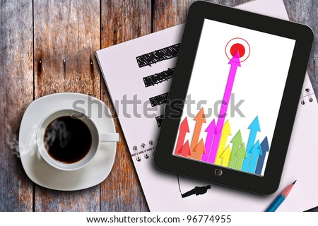 Cup of coffee and i pad. - stock photo