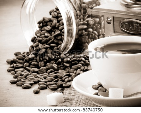 cup of coffee and jar on sepia - stock photo