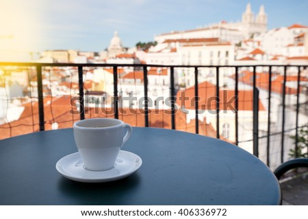 Cup of coffee and Lisbon cityscape, Portugal - stock photo