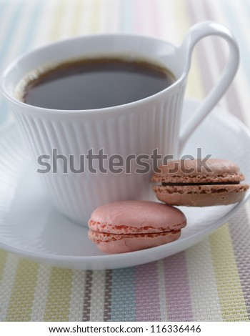 ... and a cup of coffee on a rustic table cup of black coffee and macarons
