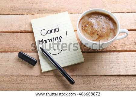 Cup Of Coffee And Note GOOD MORNING On Wooden Background
