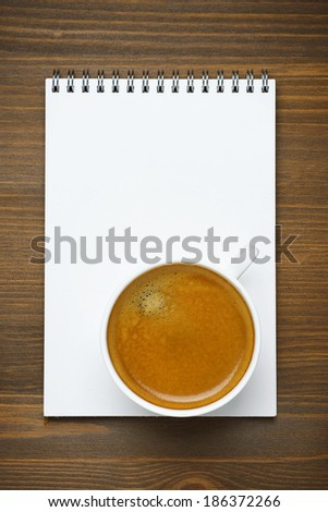 cup of coffee and note pad, concept photo, top view, vertical - stock photo