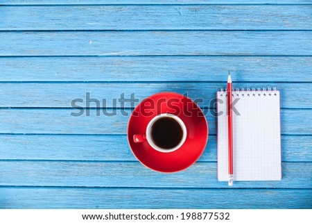 Cup of coffee and notebook. - stock photo