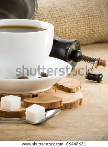 cup of coffee and roasted beans on sack - stock photo