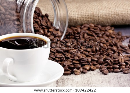 cup of coffee and roasted beans with pot - stock photo