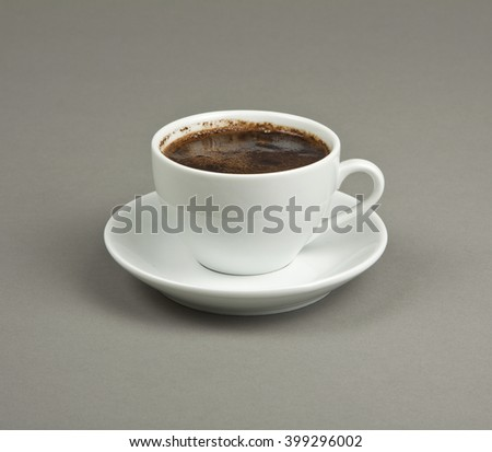Cup of coffee and saucer on a gray background - stock photo