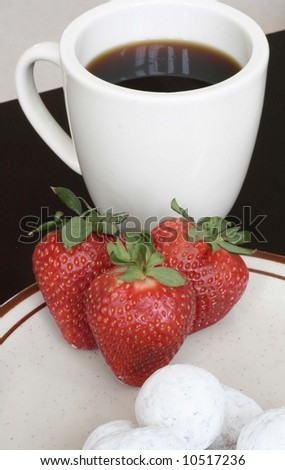 Cup of coffee and strawberries - stock photo