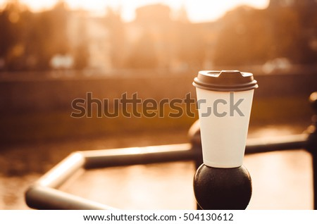 cup of coffee and the sunset of sun