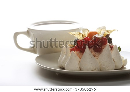 Cup of coffee and white cake  - stock photo