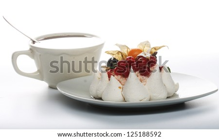 Cup of coffee and white cake with fruits - stock photo