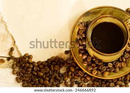 cup of coffee and white paper with free space to write on it - stock photo