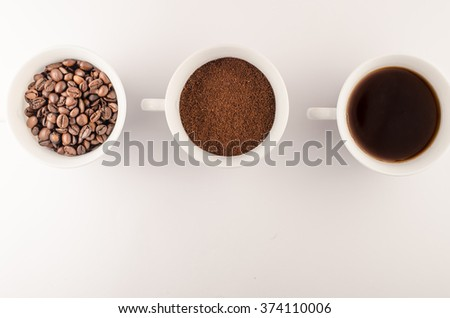 cup of coffee beans, ground coffee cup, a cup of coffee on a white background - stock photo