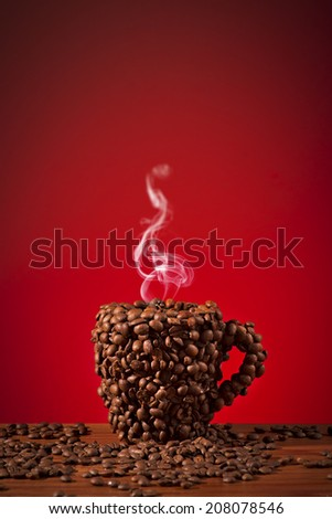 Cup of coffee beans, Made a coffee cup with coffee beans - stock photo