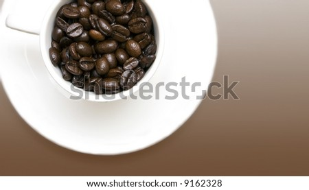 cup of coffee beans on chocolate background