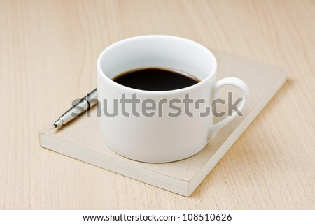 Cup of Coffee, Book and Pen On Wooden Background