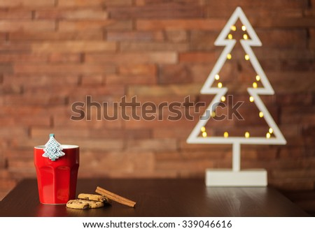 Cup of coffee, cookies and Christmas decor - stock photo