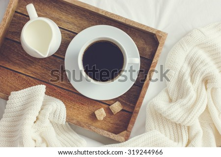 cup of coffee, cream and brown sugar on wooden tray, toned,  top view - stock photo