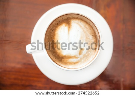 cup of coffee, cup of coffee on brown wooden table - stock photo