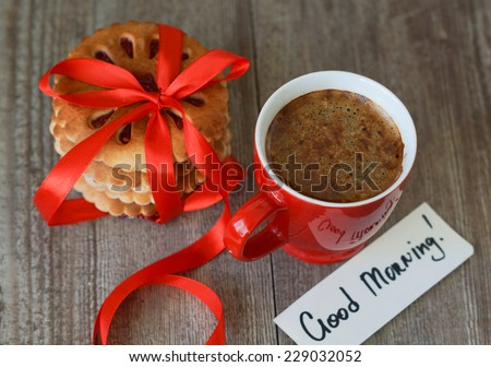 Cup of coffee, flowers, cookies and note - stock photo