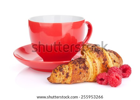 Cup of coffee, fresh croissant and berries. Isolated on white background - stock photo