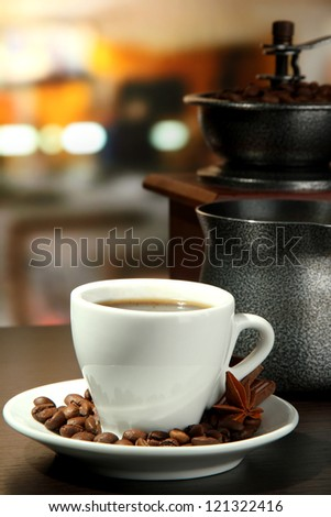 cup of coffee, grinder, turk and coffee beans in cafe
