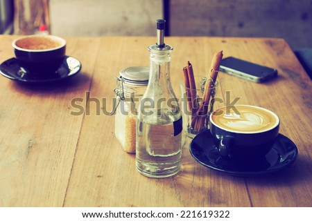 cup of coffee in coffee shop vintage color - stock photo