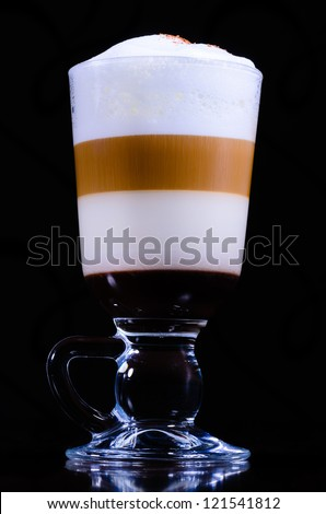 Cup of coffee in four colors on a black background