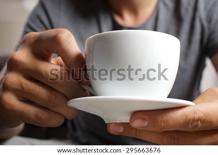cup of coffee in the hands - stock photo