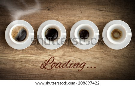 Cup of coffee - morning loading concept - stock photo