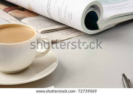 Cup of coffee near press - stock photo