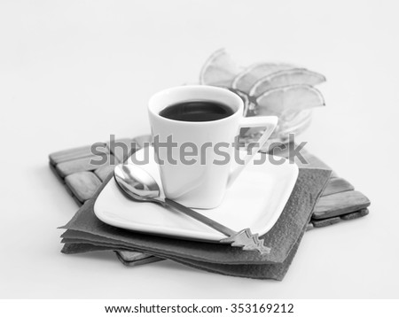 Cup of coffee of espresso and slices of a lemon on a background