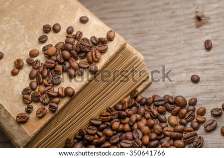 cup of coffee,old books coffee beans on a wooden table