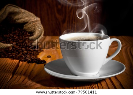 Cup of coffee. On a background a sack with coffee grains - stock photo